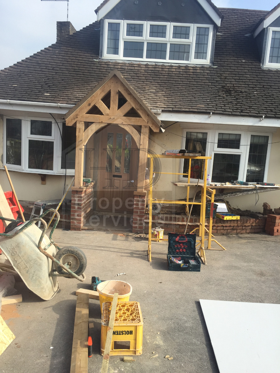 Before and after photos. New front doorway with gabled canopy ...