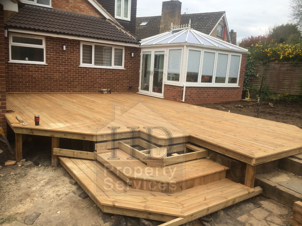 Before and after photos of a garden make over raised for Garden decking before and after