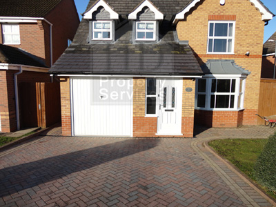 Before and after photos. Porch garage extension with a