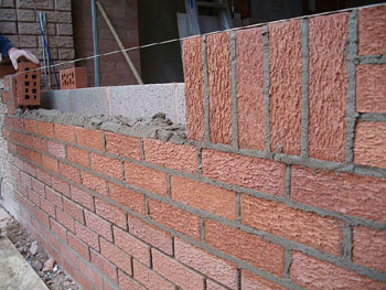 The new brickwork is matched to existing brick colour & laying design