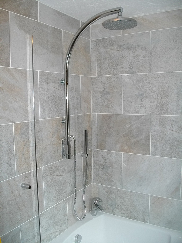 over bath shower prior to installation of the shower screen rail - Bathroom Tiles Redditch