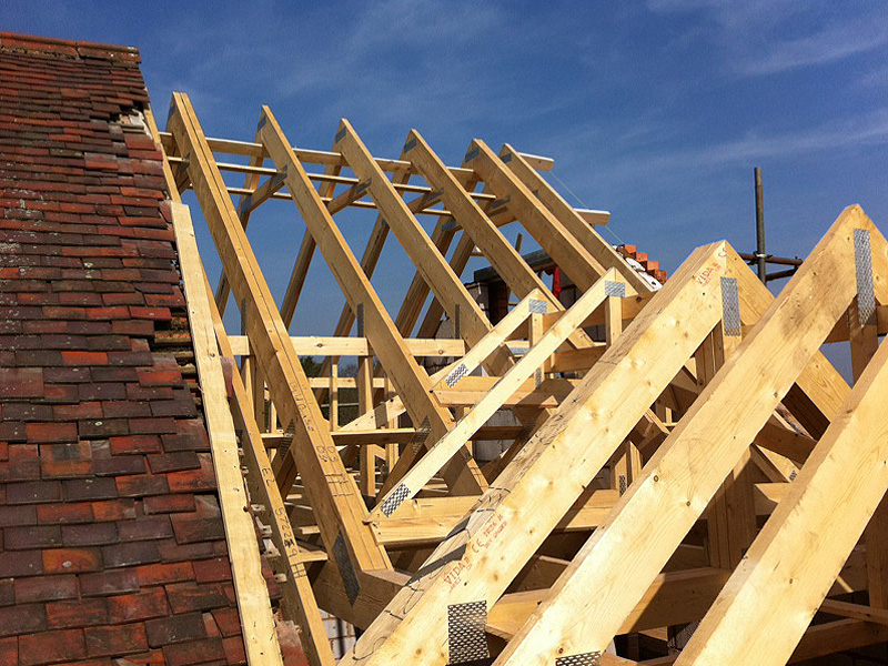 Before after photos of the construction of a two storey for Roof trusses installation