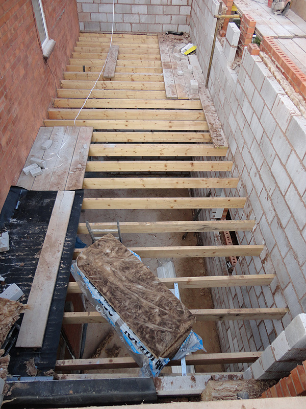 Before after photos of the construction of a two storey for Floor joist construction